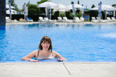 Sexy young woman in the swimming pool — Stock Photo