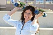 Goofy girl with skateboard — Stock Photo