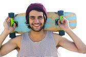 Skateboarder holding  skateboard behind  head. — Foto Stock