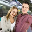 Couple at a train station — Stock Photo #59018033