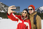 Couple taking a wintersport selfie — Stock Photo