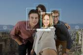 Four people taking a selfie — Foto Stock