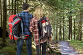 Backpacking couple in a forest — Stock Photo