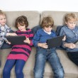 Постер, плакат: Brothers and sister using tablets