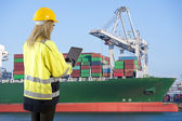 Female docker in industrial harbor — Stock Photo