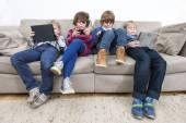 Brothers and sister on sofa — Stock Photo