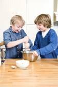 Kids having fun during a baking workshop — Stock Photo