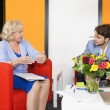 Businesspeople Discussing At Office Lobby — Stock Photo #77530788