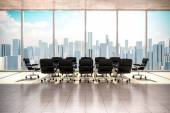 Modern office interior with beautiful worm daylight and city skyline in the background — Stock Photo