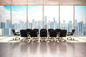 Modern office interior with beautiful worm daylight and city skyline in the background — Stockfoto
