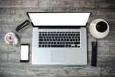 Top view of work place with laptop and documents — Stock Photo