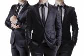 Close up image of three business men in black suit — Stock Photo