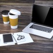 3d render-workplace setup with laptop documents and coffee cups — Stock Photo #80372586