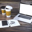 3d render-workplace setup with laptop documents and coffee cups — Stock Photo #80372720