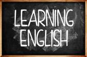 Learning English title on Language School Blackboard — Stock Photo