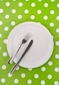 Empty white flat plate with fork and knife — Stock Photo