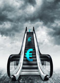 Euro symbol on escalators — Stock Photo