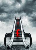 Pound symbol on escalators — Stock Photo