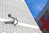 Security camera on the wall as Private property protection. — Stock Photo
