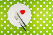 Red heart served on white plate — Stock Photo