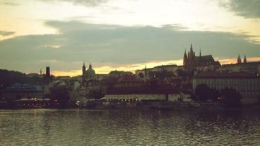 Night panorama of Prague city, Czech Republic with Castle and Vltava river as famous tourist sightseeing landmarks — Stock Video