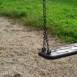 Empty swing seat swaying at playground in the park. — Stock Video #53396529