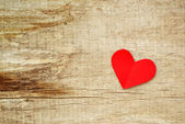 Red paper heart on grunge wooden background — Stock Photo