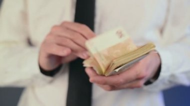 Businessman counting 50 euro banknotes money. Concept of salary and finances — Stock Video