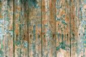 Paint peeling from wood background — Stock Photo