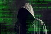 Faceless hooded anonymous computer hacker — Stock Photo