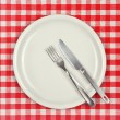 Empty plate on restaurant table — Stock Photo #60282063