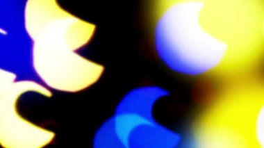 Colorful defocused blinking bokeh festive lights as abstract background — Stock Video