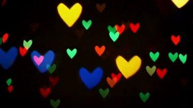 Colorful defocused blinking heart bokeh festive lights — Stock Video