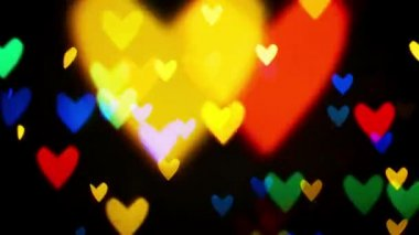 Colorful defocused blinking heart bokeh festive lights as abstract background — Stock Video