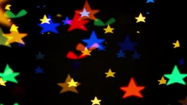Colorful defocused blinking star shaped festive lights as abstract background — Stock Video