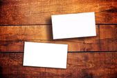 Blank Horizontal Business Cards on Wooden Table — Stock Photo