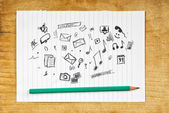 Doodle Multimedia Icons on Paper — Stock Photo