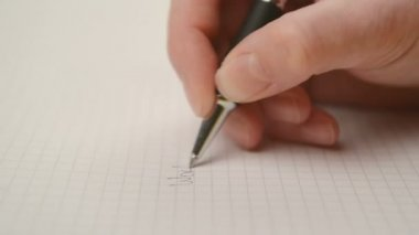 Woman writing notes in notebook, close up steady footage with selective focus on hand — Vídeo de stock