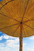 Wickerwork Sun Umbrellas on the beach — Stock Photo