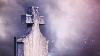Cross on the cemetery during snowfall — Wideo stockowe