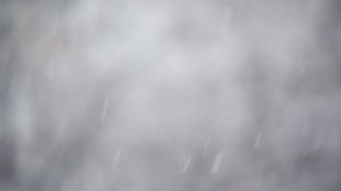 Snowfall from as winter season weather background with shallow depth of field — ストックビデオ