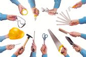 Male worker's hand holding various craft trade tools — Stock Photo