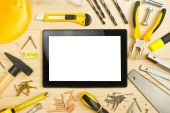 Digital Tablet and Assorted Carpentry Tools  on Workshop Table — Stock Photo