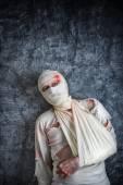 Ranny człowiek z głową Bandaże — Zdjęcie stockowe