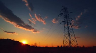 Silhouette of Electric Pylon and Power line in sunset, Time Lapse — Stock Video