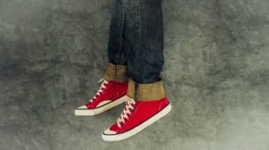 Loopable Stop Motion Animation of Young Person in Jeans and Red Sneakers Walking — Stock Video
