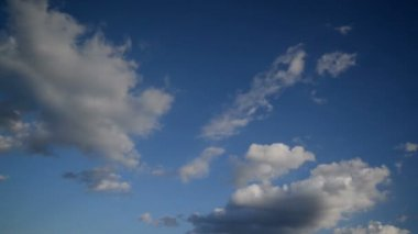 Time Lapse Full HD Footage of Beautiful White Clouds Flowing Fast Across the Blue Spring Sky — Stock Video