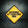 Entering at Your Own Risk Grunge Yellow Warning Sign — Stock Photo #69539885