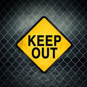 Keep Out Grunge Yellow Warning Sign on Chainlink Fence — Stock Photo