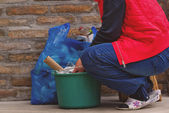 Woman Putting Garbage in Can and Plastic Bag — Stock Photo